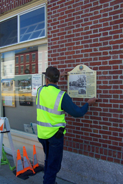 Hanging a panel, Thomaston, Maine